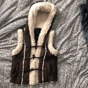 Cozy sleeveless vest with hoodie